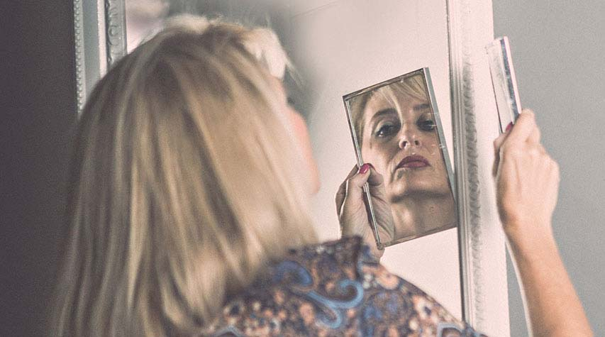 Sheryl Puterman looking into a mirror