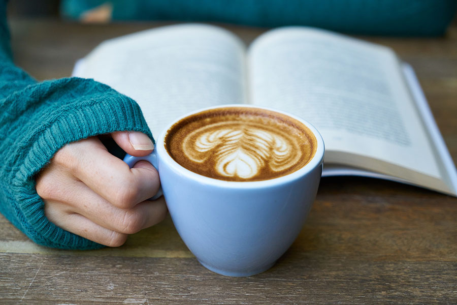 Book and cup of coffee